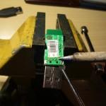 Der USB-Stecker wird aus dem Adapter gelötet