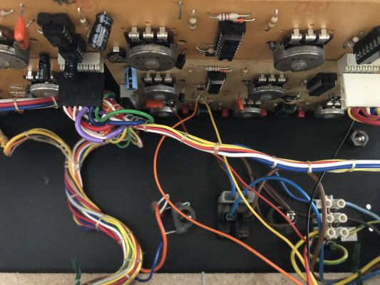 Inside the JEN synth: two wires leading to the filter PCB